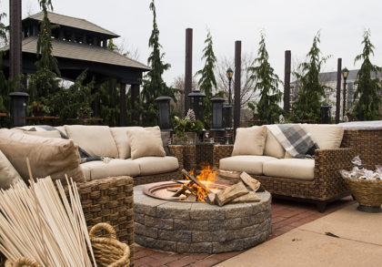 Exterior patio set up with fire pit and sofas for ski lodge themed corporate holiday party