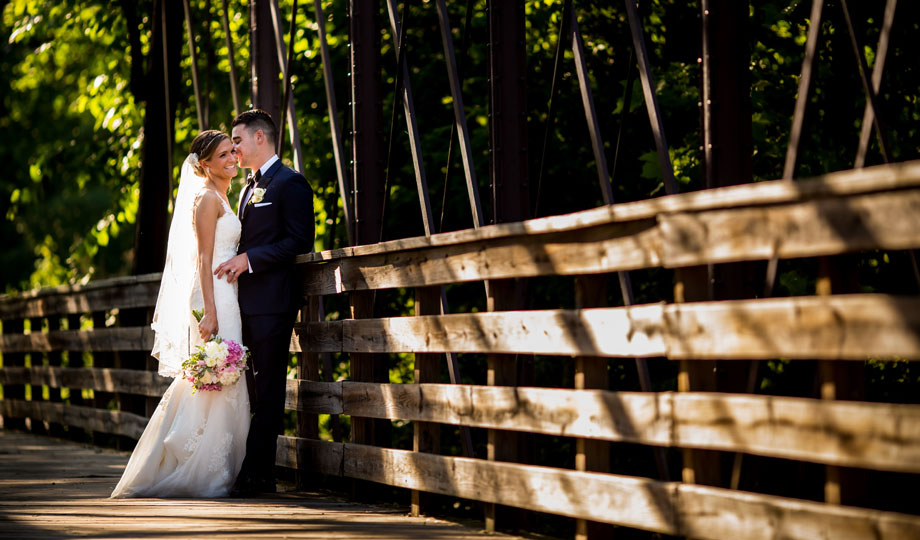Bride and groom on the bridge at the Phoenixville Foundry